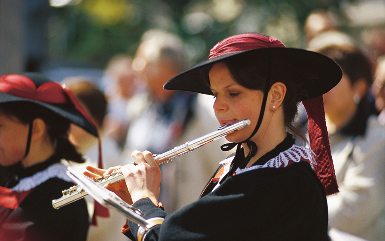 A woman playing the fluteat an event