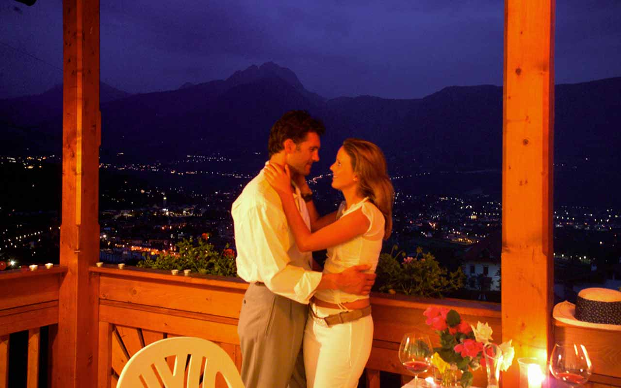 Romantic moments for a couple on the terrace of hotel Kristall, Marlengo