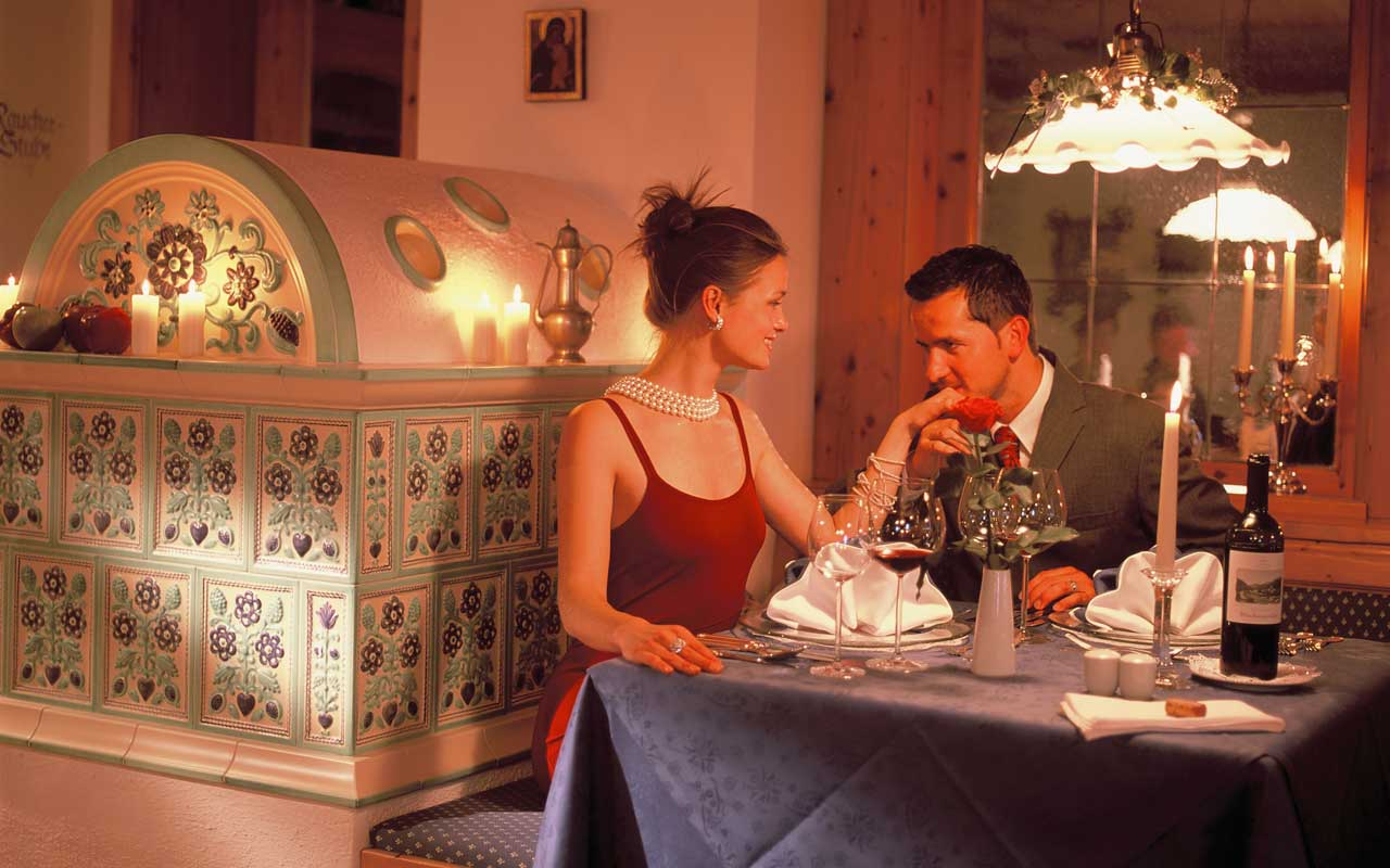 A couple during a dinner by candle-light