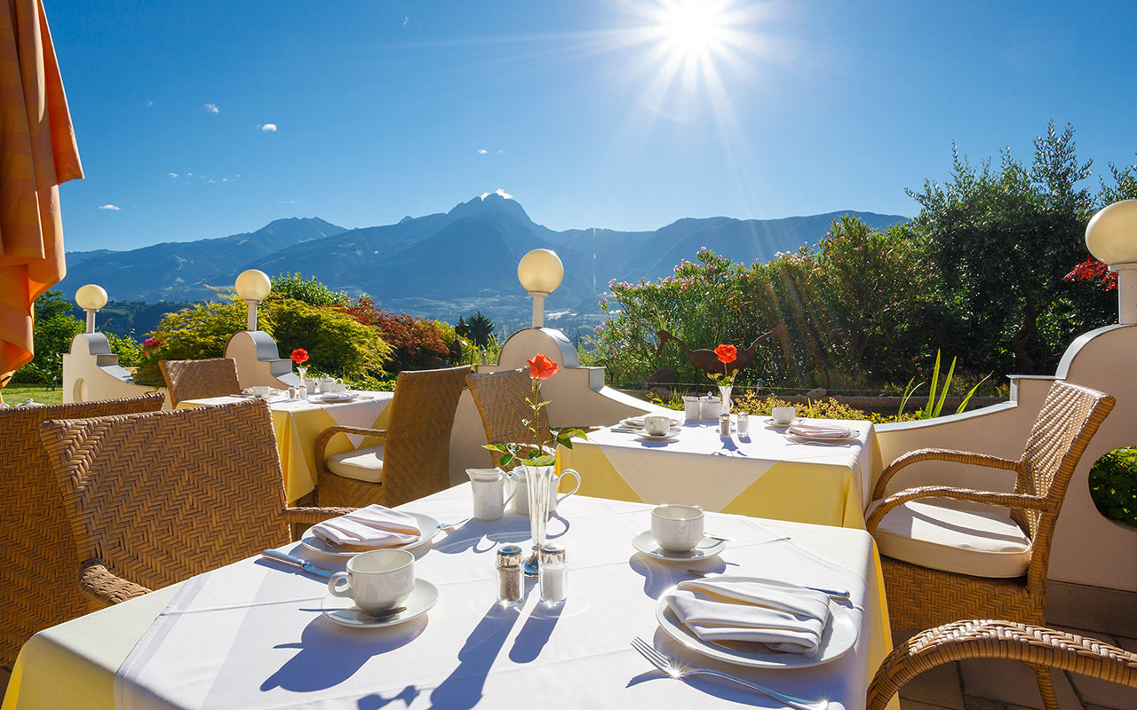 Coffee-laid on the sunny terrace of Hotel Kristall, overlooking the Merano area